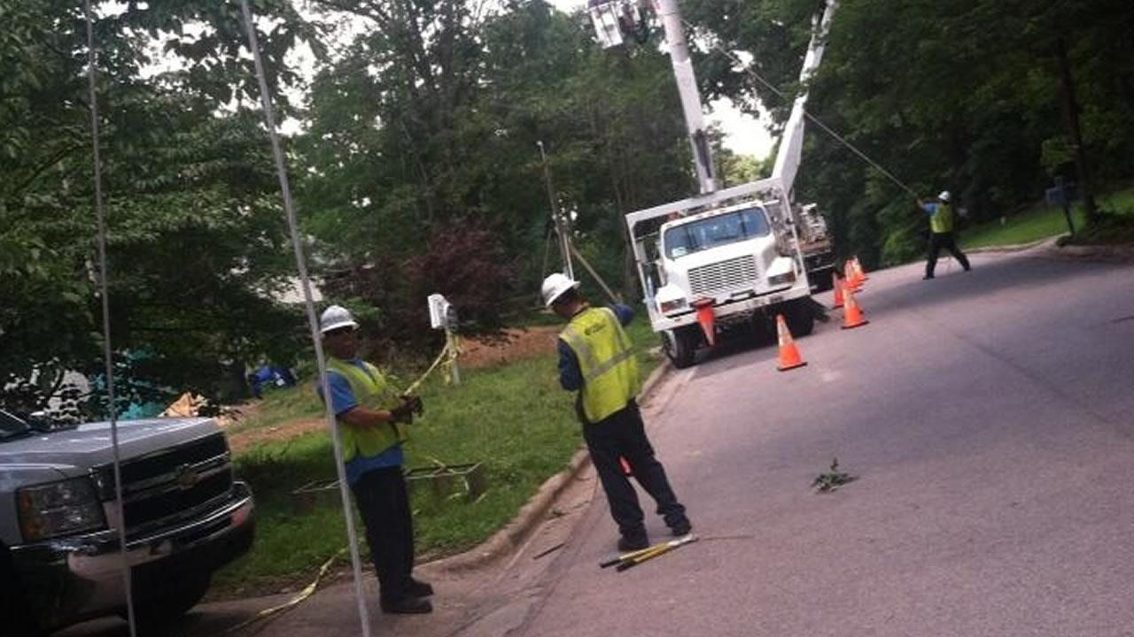Power company workers restoring electricity to homes in the Triangle.