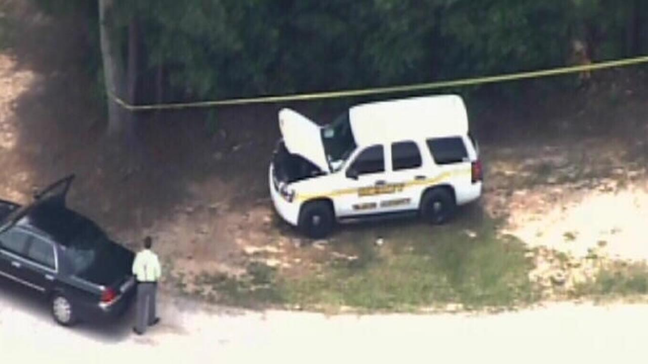 Authorities investigate at a Kerr Lake boat ramp.