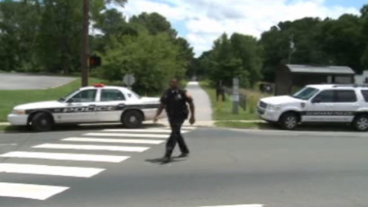 Durham police investigate a robbery along the American Tobacco Trail