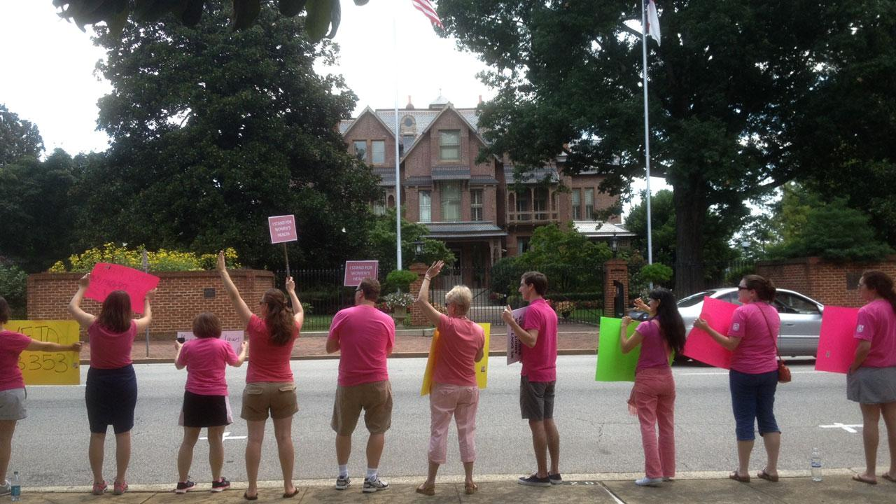 Abortion-rights supporters protest in front of Governors Mansion