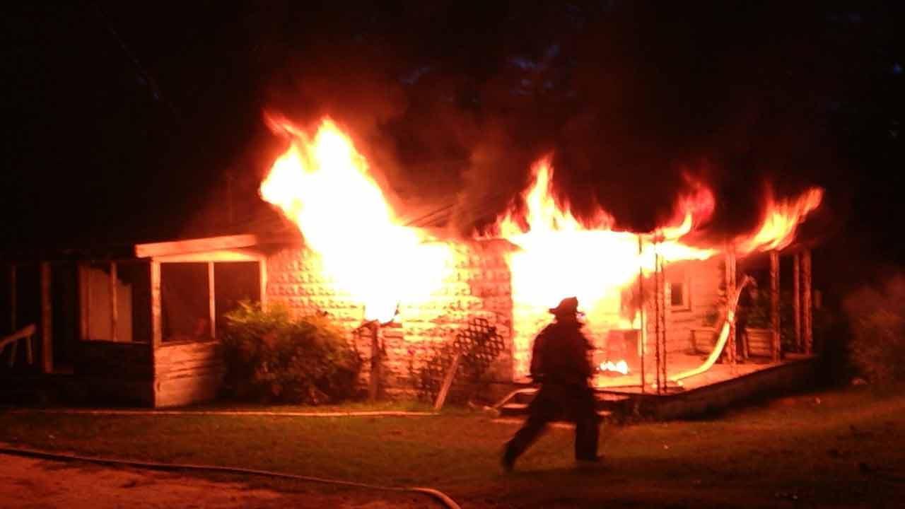 Firefighters battle house fire in Four Oaks