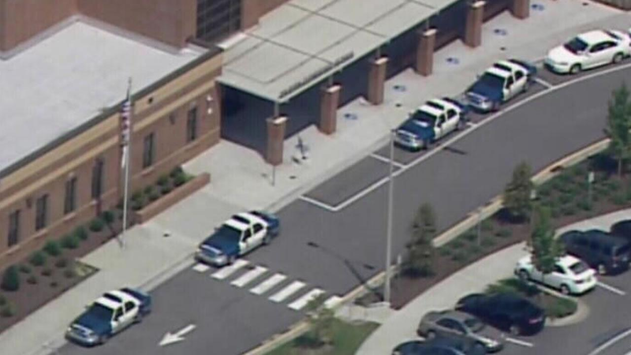 Police cars lined up outside Wilburn Elementary School in Raleigh.