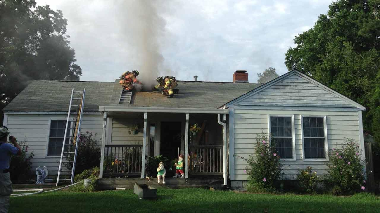 The flames tore through the attic around 6 p.m. on Old Evans Road in Garner.