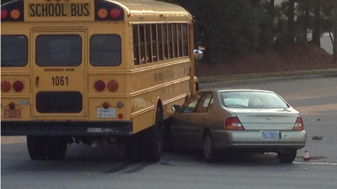 A car ended up wedged under the side of the school bus in this crash Tuesday morning.