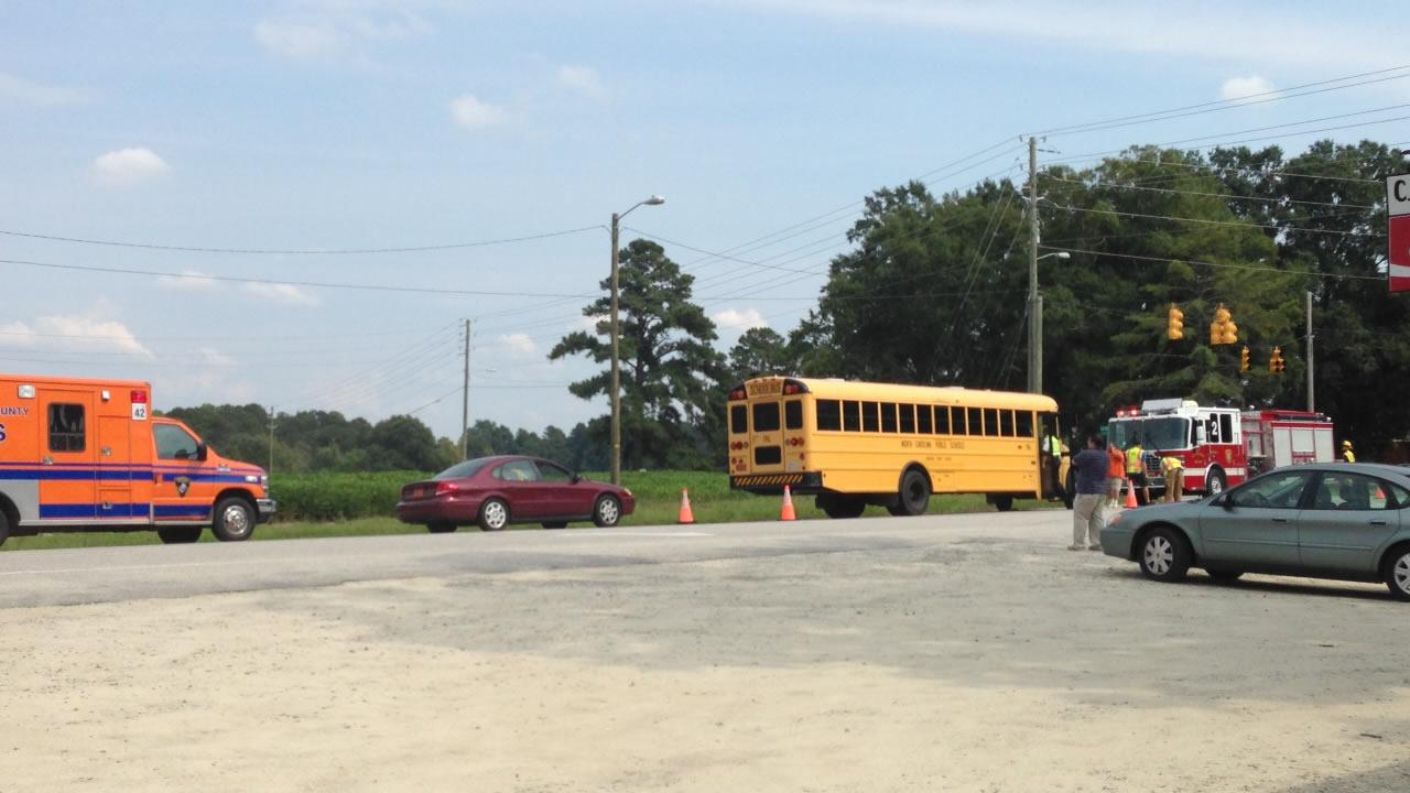 Emergency workers at the scene of a an accident involving a school bus at Buffalo Road and Covered Bridge Road northeast of Clayton in Johnston County.