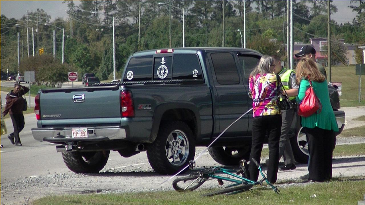 A bicyclist was hit by a SUV and a pickup truck Wednesday afternoon in Clayton.
