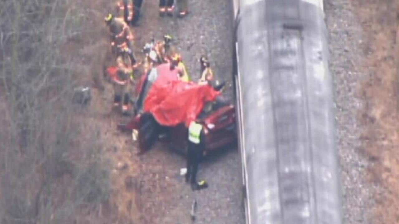 Emergency workers at the scene of an accident involving an Amtrak train and a car in Cary.