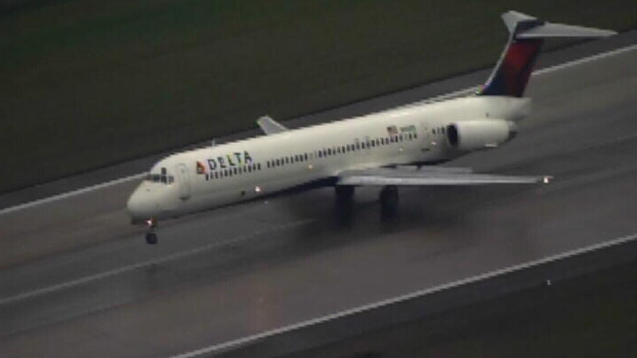 A Delta Airlines MD-80 lands at RDU after reporting a mechanical problem.