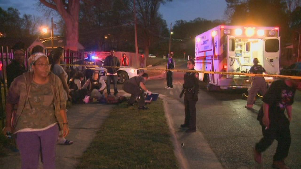 Emergency workers on the scene of a Wabash Street shooting in Durham.
