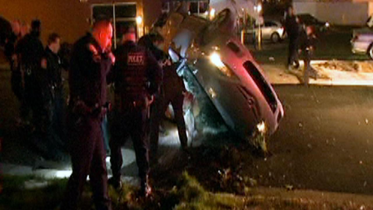 Police dragged two men out of an overturned car near the intersection of W. Main and Iredell streets in Durham late Sunday.