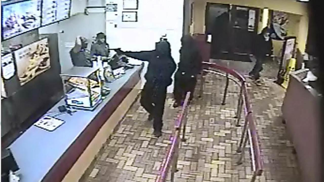 Authorities in Carrboro are trying to identify four suspects involved in a robbery at a Burger King Tuesday night.