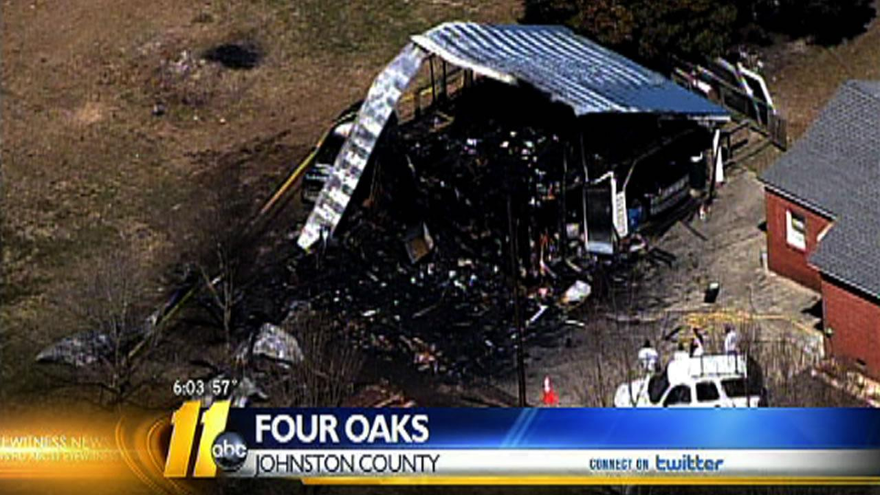 The fire began Saturday morning in the barn behind a home on N.C. Highway 301 South in Four Oaks.