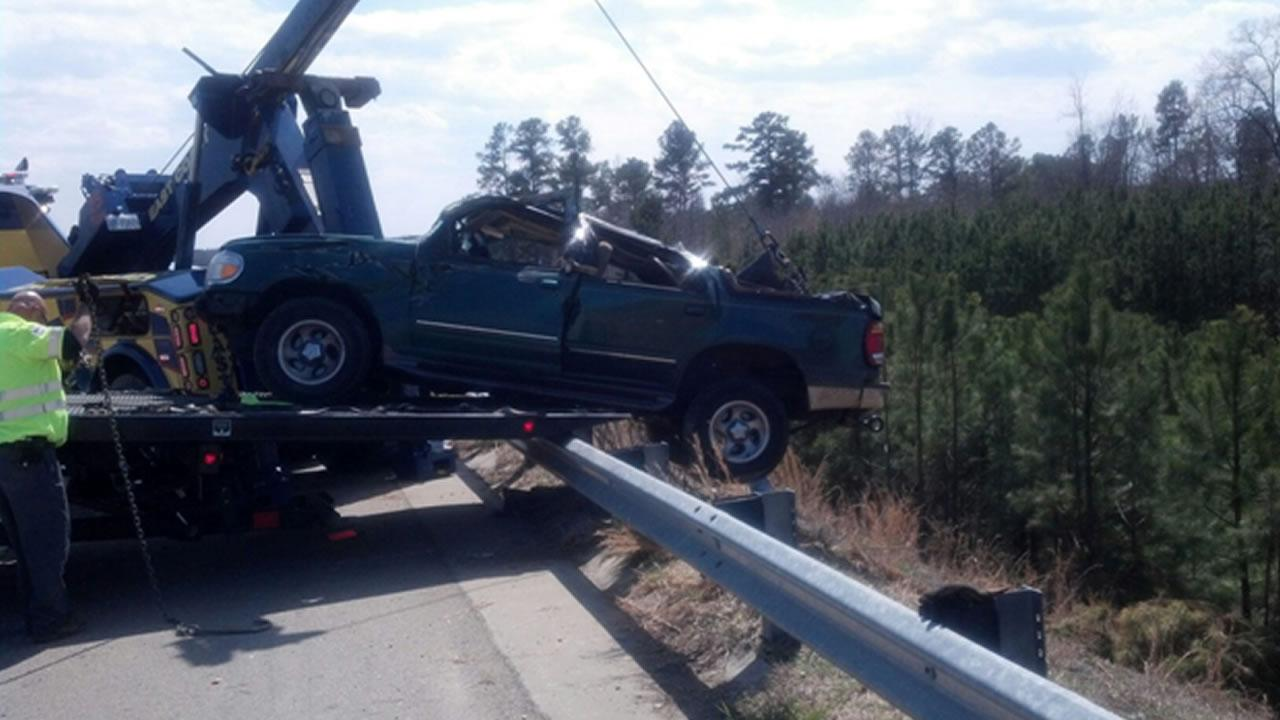 Crews hoisted the Ford Explorer out of the embankment on US-64