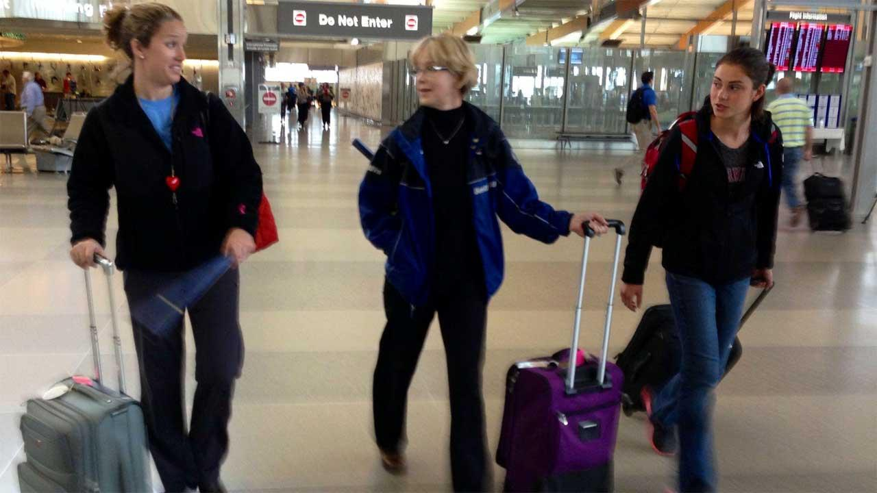 Marsha Kouba (center) arrived at the Raleigh Durham International Airport from Boston Tuesday morning with her daughter Jessica (left) and niece Emma.
