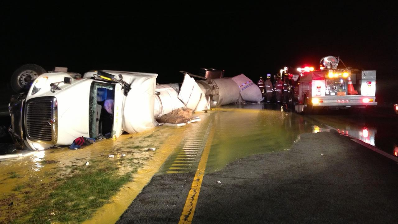 A tanker truck carrying orange juice overturned on I-95 Saturday morning, killing one person and injuring another, according to Highway Patrol.