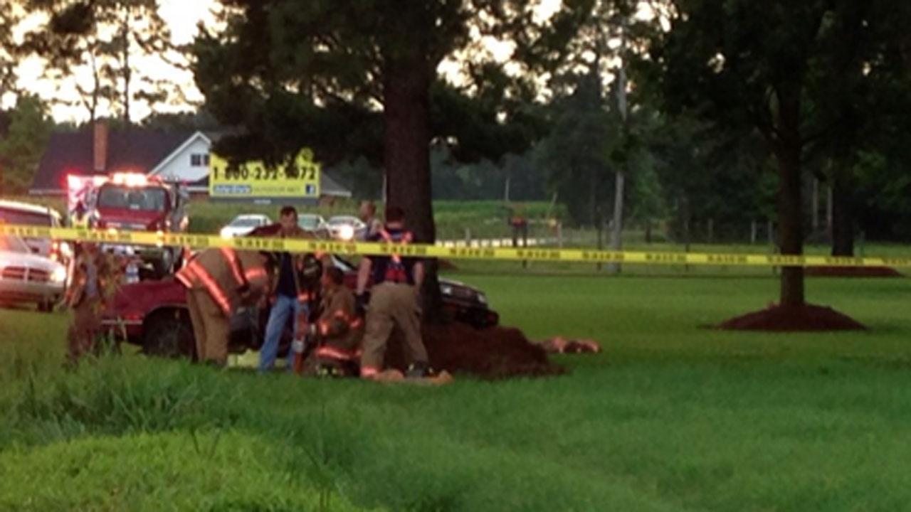 Man killed, woman injured after crashing into tree