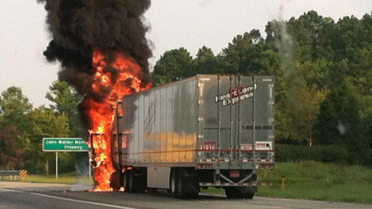 Traffic was backed up for miles along Interstate 40 in Durham County Wednesday morning after a tractor-trailer caught on fire.