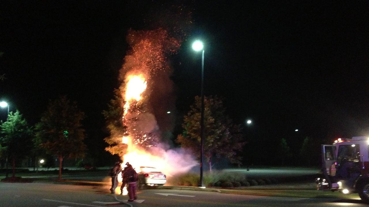 A car burst into flames Thursday night when the driver hit a tree in front of Johnston Medical Center of Clayton.