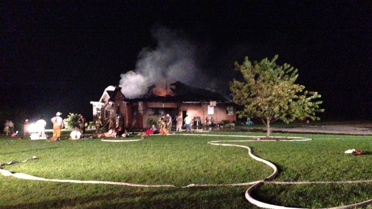 A brick home off Highway 56  just east of Louisburg in Franklin County is being called a total loss after catching fire late Thursday night.