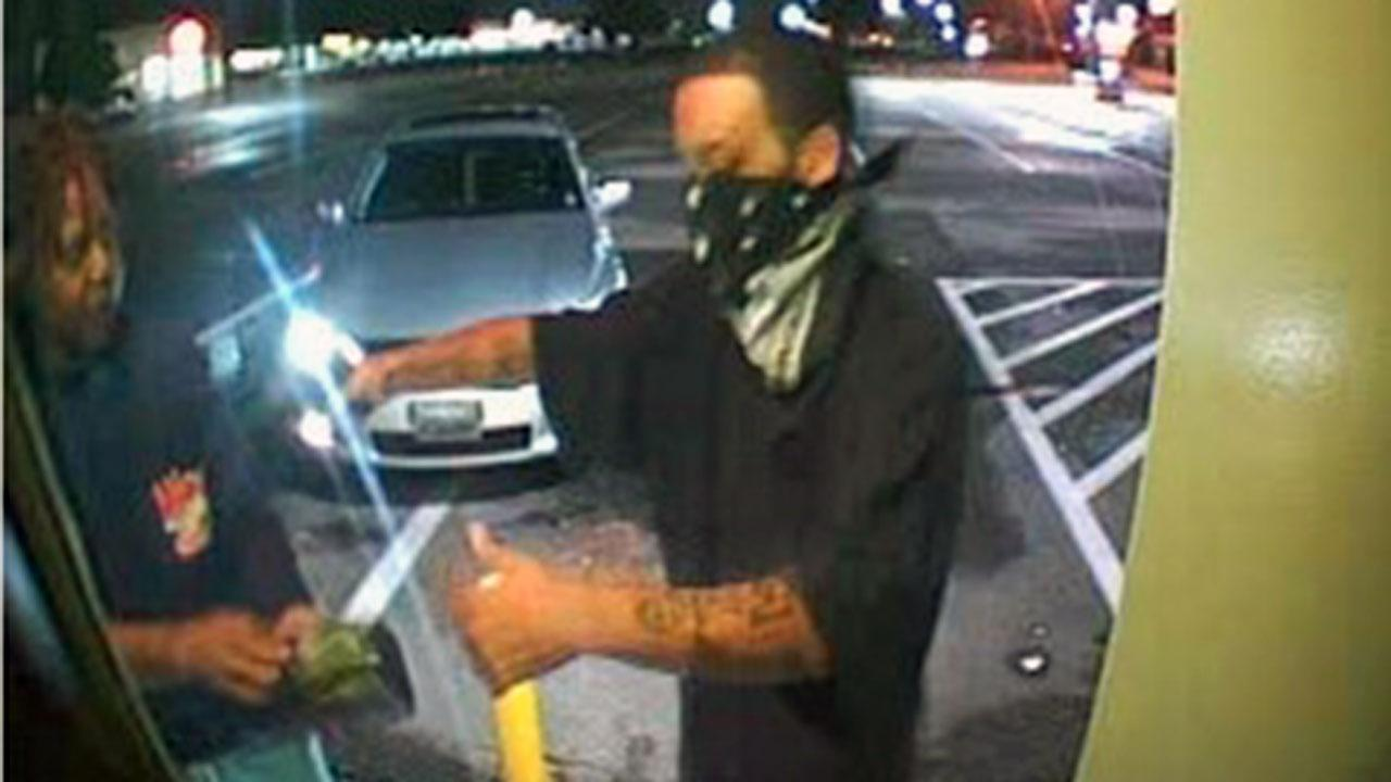 Hope Mills Police are searching for a man who robbed his victim at gunpoint at the Cash Point ATM of Village Shopping Center.