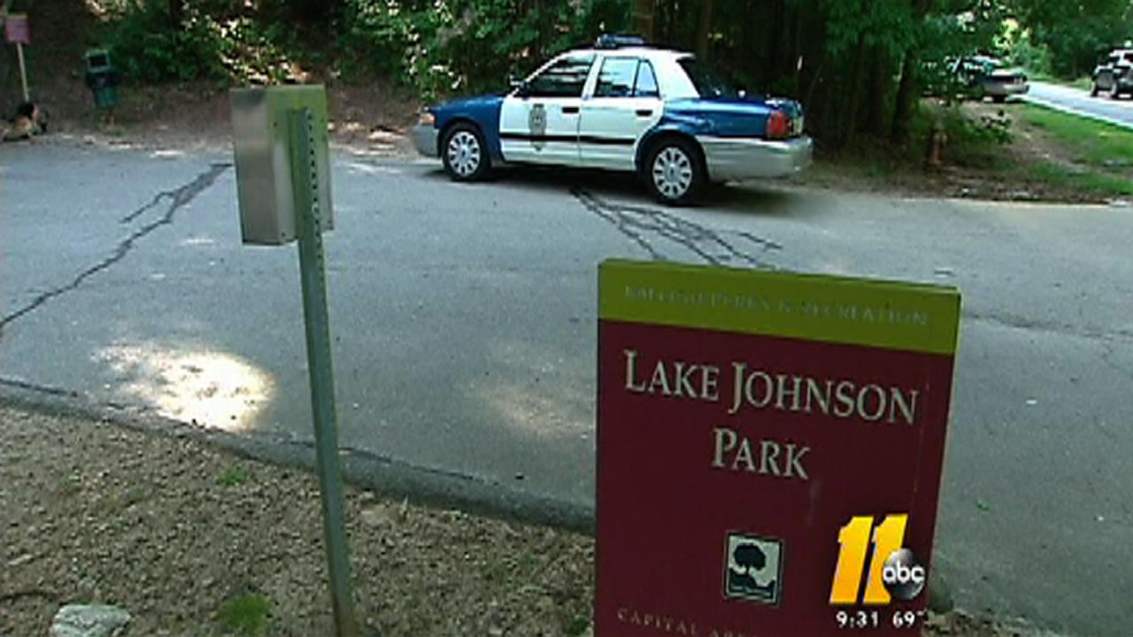 The body was found Saturday morning around 8:15 a.m. along a walking trail at Lake Johnson