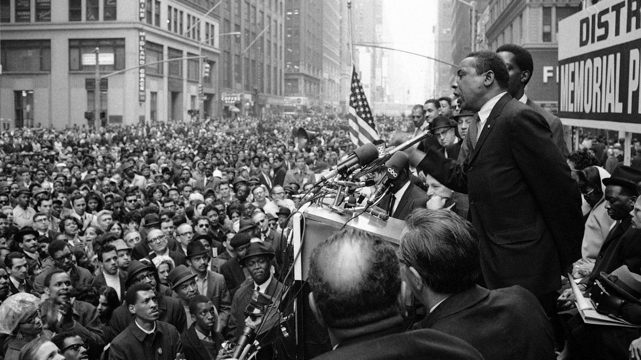 Floyd McKissick, head of CORE, addresses a crowd who stopped work to attend a memorial meeting for Dr. Martin Luther King, Jr., in New York, April 8, 1968. McKissick told the crowd: The reason youre here today is because of an act of violence.