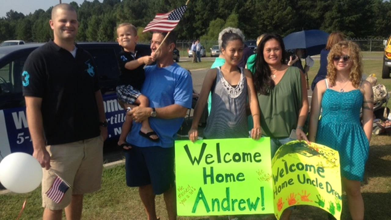 Family members await the arrival of their loved ones Sunday as nearly 100 soliders return home from a year overseas.