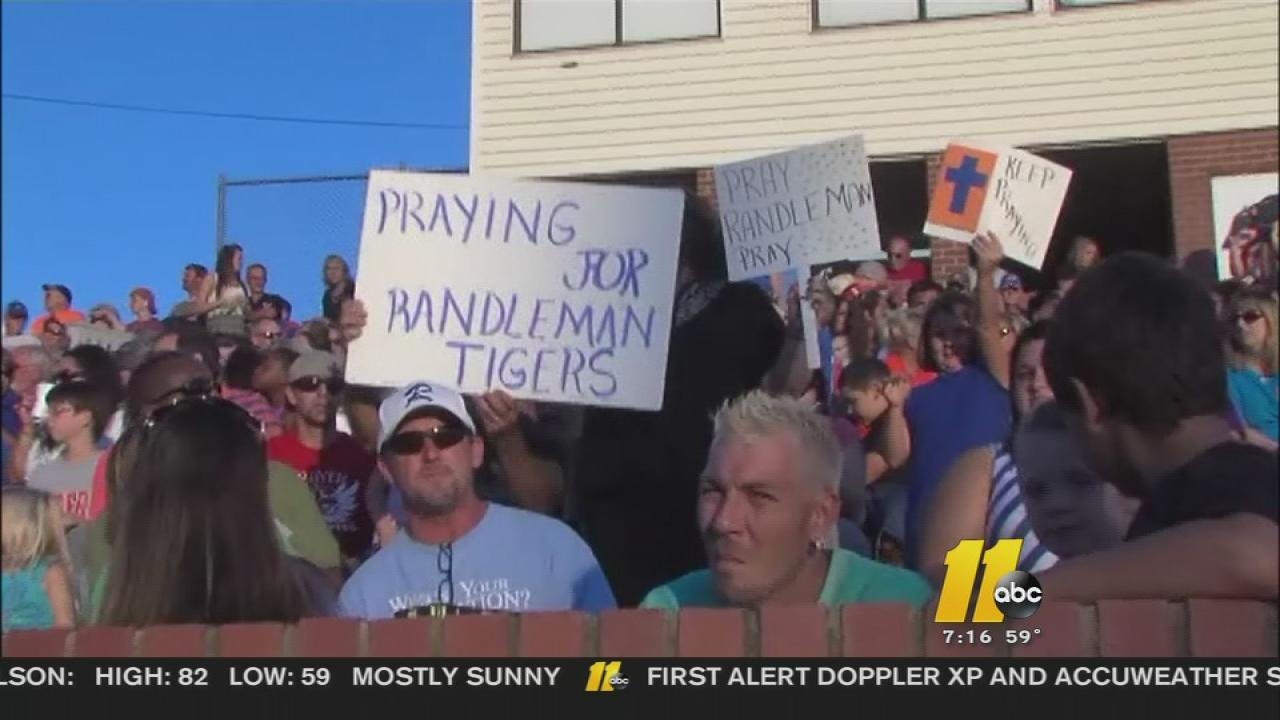 Supporters of the prayer held signs at Friday nights game at Randleman High School