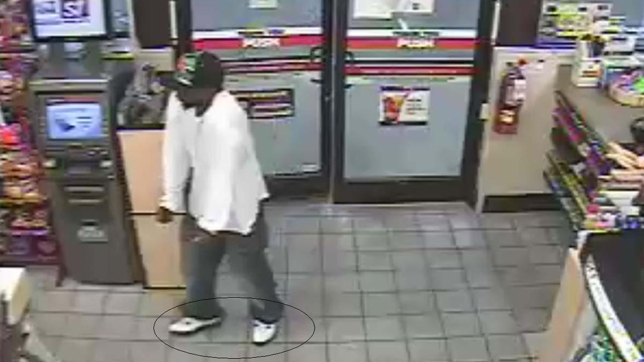 Police say the man pictured here wore the same white tennis shoes to another convenience store robbery.