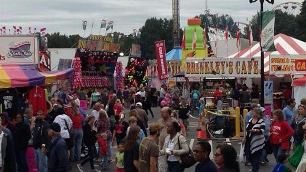 Fairgoers enjoy a Friday afternoon full of food and rides.