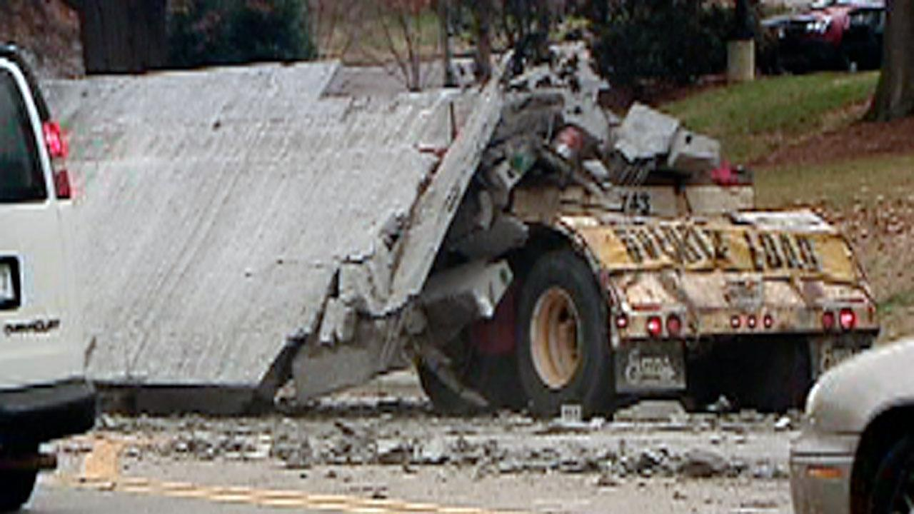 A tractor-trailer hauling concrete barriers caused major traffic problems in Raleigh Wednesday morning after it spilled its load.