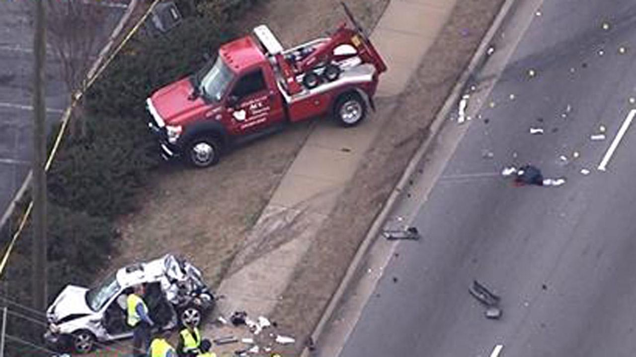 Two vehicles and a pedestrian were involved in a crash on Capital Boulevard in Raleigh.