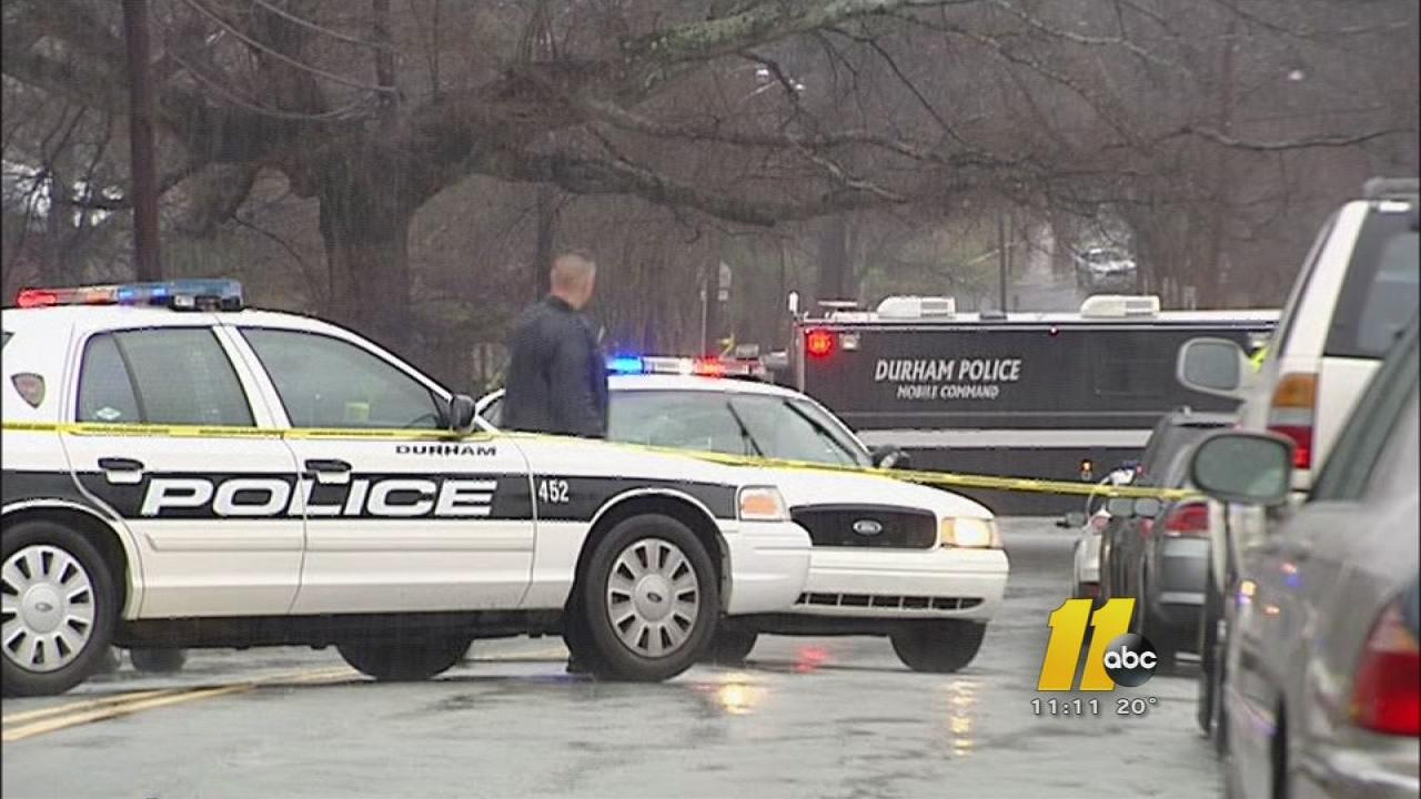 Durham police cars at a crime scene.
