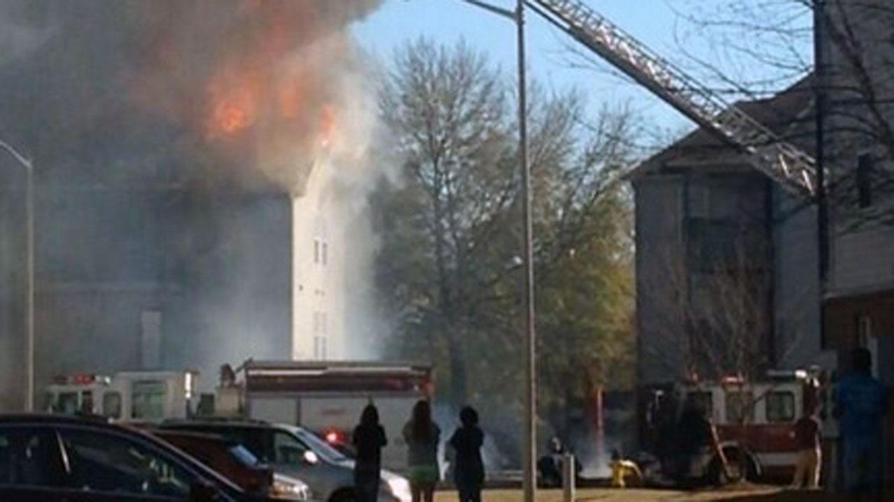 Firefighters are battling a large fire at the Brookstone Apartments in Fayetteville.