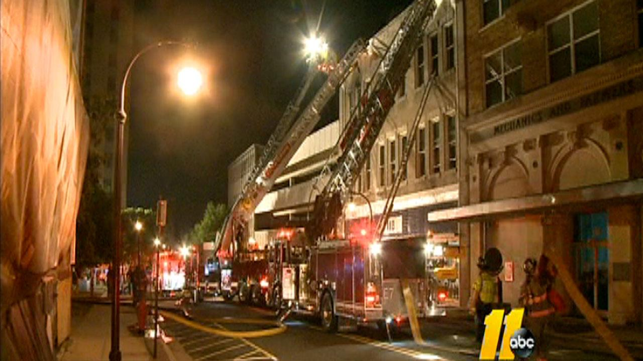 An early morning fire damaged part of a historic downtown Durham building Wednesday.