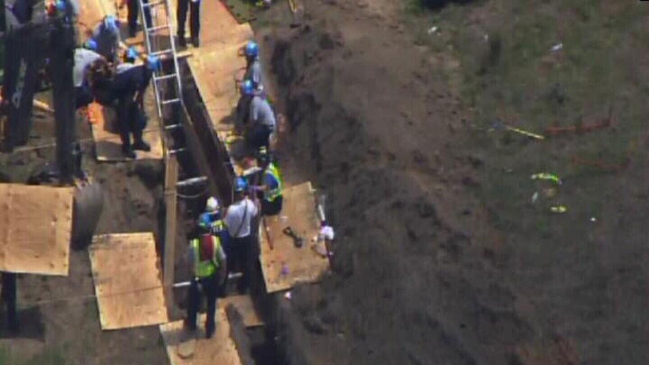 Rescue efforts are underway in Fayetteville after a person got stuck in a trench Wednesday morning.