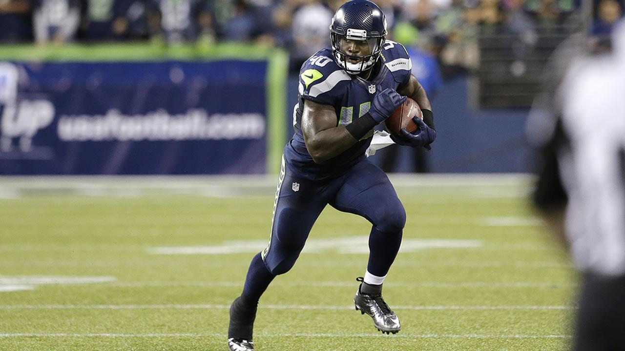 Seattle Seahawks Derrick Coleman rushes against the Oakland Raiders in the first half of an NFL preseason football game, Thursday, Aug. 29, 2013, in Seattle.
