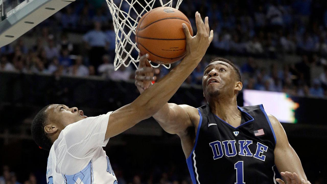 Dukes Jabari Parker (1) blocks North Carolinas Nate Britt during the first half of an NCAA college basketball game in Chapel Hill, N.C., Thursday, Feb. 20, 2014.