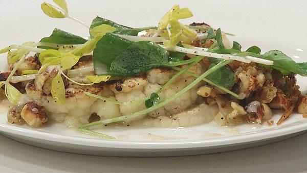 Seared Cauliflower with Golden Raisins, Watercress, Crispy Quinoa, Hazelnuts, and Sherry Dressing