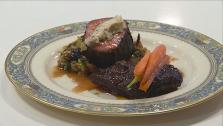 Black Garlic-Crusted Filet with Braised Short-Rib, Baby Carrots, Brussels Sprouts and Shallot-Maytag Blue Cheese Butter