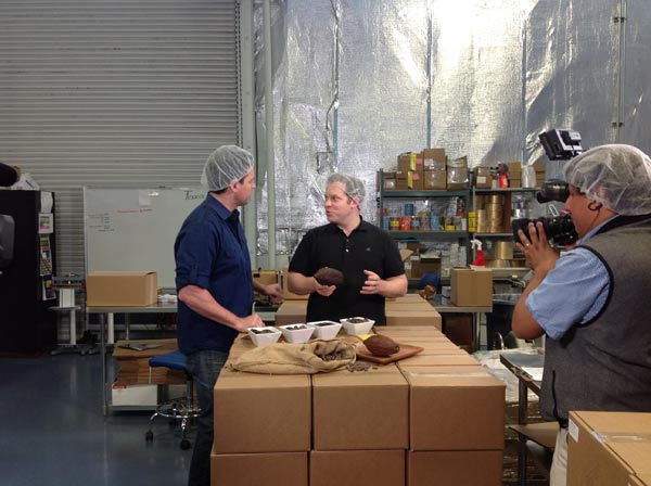 Brad Kintzer of TCHO Chocolates shows Ryan what...