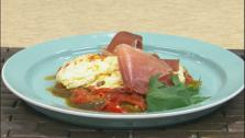 Piperade is a dish of onions, peppers, and tomatoes that are stewed together with ham and seasoning and served over eggs.