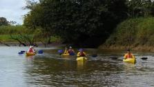 The Motion crew kayaks down river as part of their journey to their Costa Rican lodge.