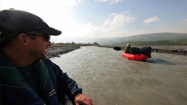 Greg Aiello Crosses the Teklanika River in the Alaskan Wilderness