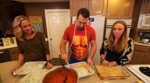 Daughters Melissa and Halley are experts with the lasagna assembly line.