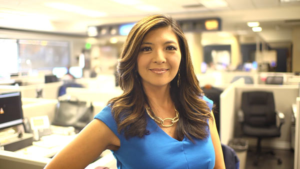 Margot Kim takes a moment to smile for the camera while she gives the My Family Recipe Rocks crew a tour where she works at ABC30 in Fresno, California.